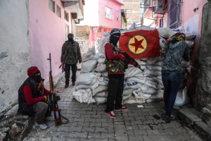 "A flag of Kurdish workers Party (PKK) hangs on a barricade as armed kurdish militants man a barricade, on November 18, 2015 in the Sur district of Diyarbakir. Tensions rose when pro-Kurdish MP Leyla Zana began her oath with ""Biji Asiti"", or ""Long live peace"" in Kurdish. The phrase triggered a storm that recalled her memorable swearing-in 24 years ago when she also spoke the language that was then still taboo in public. AFP PHOTO/ILYAS AKENGIN        (Photo credit should read ILYAS AKENGIN/AFP/Getty Images)"